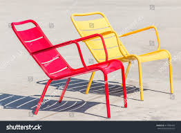 empty red yellow metal outdoor chairs stock photo 417856429