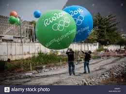 large balloons workers with large balloons featuring the writing 2016