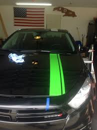 lime green dodge dart pitch black dart with a side