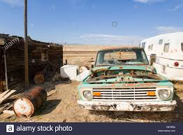 Old Ford Truck Junkyard - old ford truck in an abandoned town in western united states stock