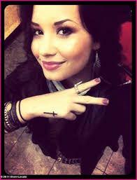 demi lovato cross tattoo on her hand meaning of the religious tattoo