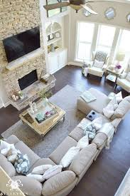 Windows Family Room Ideas Two Story Living Room With Stacked Fireplace And Built Ins