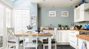 in this large family kitchen the white units and wooden worktops