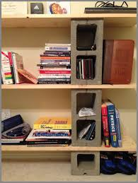 three tiered of diy cinder block bookshelf with unvarnished wooden