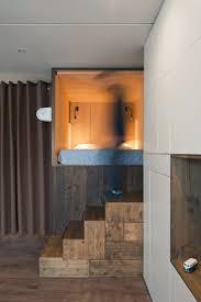 the designer u0027s small studio apartment features an ingenious loft