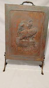 embossed copper fireplace screen