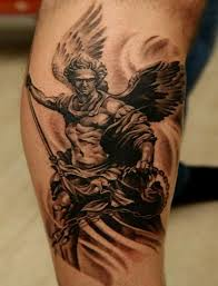 black and grey archangel on right leg my tatts js