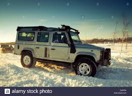land rover discovery camping land rover defender 110 suv front on background the russian winter
