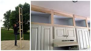 how to make cabinets go to ceiling extending kitchen cabinets up to the ceiling reality