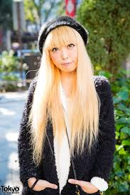 harajuku singer w blonde hair in faux fur cardigan ankle boots