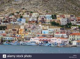 Italian Style Houses by Italian Style Houses And Fishing Boats Pothia Kalymnos Greece