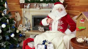 santa claus working shopping gifts on line with tablet christmas