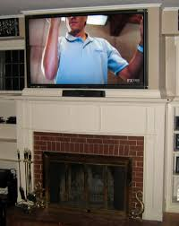 smartly tv mounted above fireplace along with mount tv over