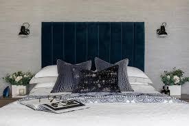 blue velvet headboard with blue faux bois pillows transitional
