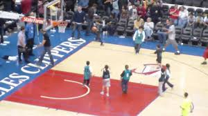 little kids playing a 5 minute basketball game at halftime during