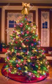 a softly glowing christmas tree in a north american home stock