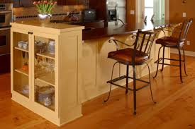 cream wooden long kitchen island with shelves and glass doors cream wooden long kitchen island with shelves and glass doors completed with black steel stools with