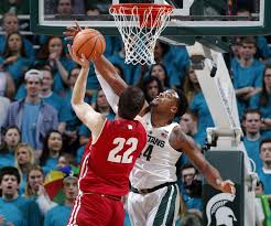 no 6 michigan st beats wisconsin 76 61 on day ad retires
