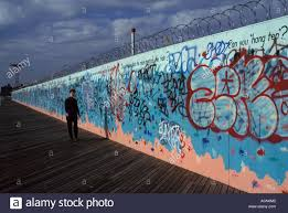 ny mural wall art grafitti graffiti peace sign pope united states graffiti covered wall coney island brooklyn new york city united states of america model released