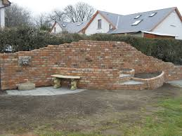 raised garden folly and water feature using reclaimed bricks