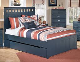 dark blue painted solid wood queen bed with trundle using blue red