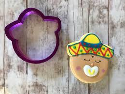 baby with sombrero cookie cutter and fondant cutter and clay