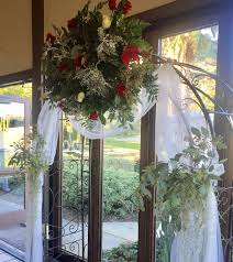 wedding arch red and white roses succulents air plant spanish