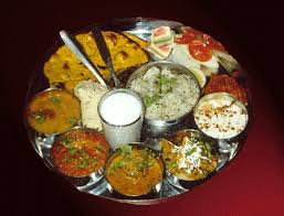 an authentic gujarati thali dish which is generally for lunch