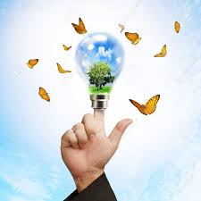 business hand powering light bulb and plant butterflies can