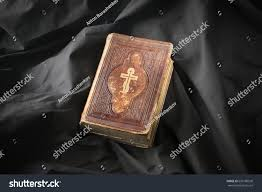 bible on dark background copy space stock photo 656180530