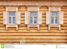 windows on the wooden house facade old russian country style