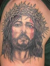cool men show jesus christian tattoo design make on upper sleeve