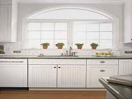 granite countertops white beadboard kitchen cabinets lighting