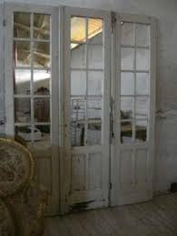 old glass doors i love the idea of these leaning against the bedroom wall