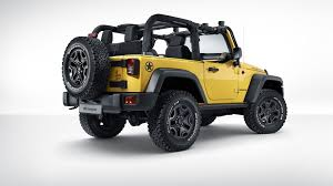 jeep wrangler logo wallpaper jeep wrangler rubicon rocks star yellow car rear view wallpaper
