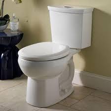 bathroom baseboard design ideas with elongated toilet plus tile