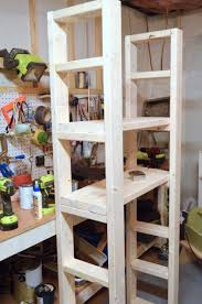 Building Wood Shelves 2x4 by Paint Storage Shelf Made With 2x4s Create And Babble