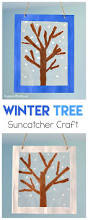 winter tree suncatcher craft using tear art winter craft and