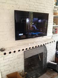 hang tv above brick fireplace design decor interior amazing ideas