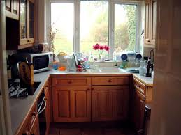 Small U Shaped Kitchen Design Ideas by Kitchen White And Bright Small Kitchen With Wooden Style