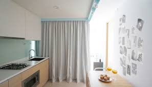 Dividing A Bedroom With Curtains Tiny Apartment Uses Fabric Curtains To Divide Its Spaces