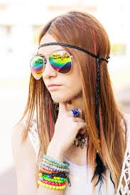 hippie style portrait of young beautiful woman with sunglasses hippie style
