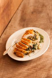 thanksgiving dinner turkey breast turkey breast stuffed with sausage garlic and spinach recipe relish