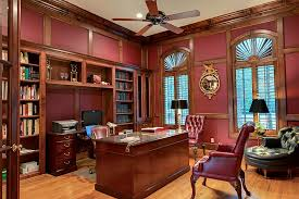 study with maroon walls with dark natural trim natural wood trim