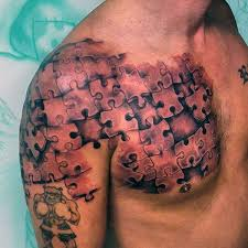 realistic man shoulder and chest puzzle tattoo