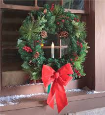 window wreath with candle outdoor decorations