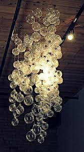 chandelier made from clear ornaments on string