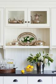 off white kitchen cabinets with vintage bronze cup pulls