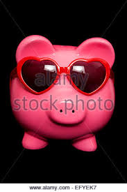 heart shaped piggy bank piggy bank and heart concept of charity and relief work