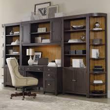 modren office wall unit custom built desk wood accented ceiling